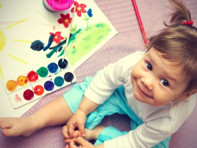Little-cute-girl-painting-sun-inside